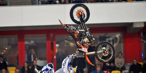 Flipping Out: Red Bull Freestyle Motocross star Mat Rebeaud from Switzerland flips for the crowd at the 2010 Race of Champions in Dusseldorf, Germany.