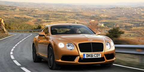 The new Bentley Continental GT V8 out for a drive on the road.
