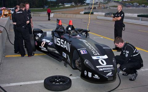 The crew preps the DeltaWing for its return to the track on Thursday at Road Atlanta.