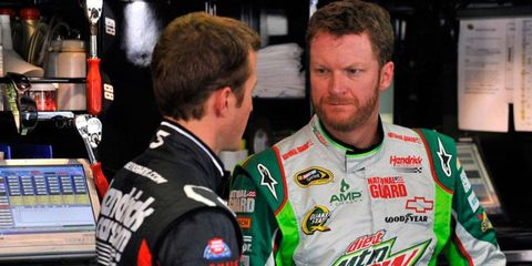 Dale Earnhardt Jr., right, will miss his second consecutive Cup Series race this weekend at Kansas.