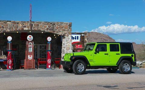 A 2013 Jeep Wrangler Sport Unlimited in Gekko green paint.