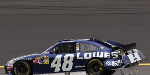 Jimmie Johnson limps back to the pits after a crash.