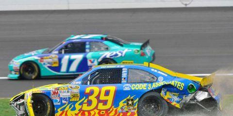 Ryan Newman spins as eventual race winner Matt Kenseth speeds past during the Hollywood Casino 400 at Kansas Speedway on Sunday.