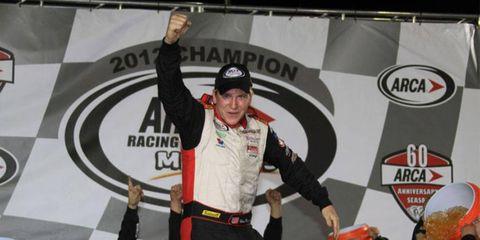Ken Buescher celebrates his championship in the ARCA Racing Series on Friday night at Kansas Speedway.