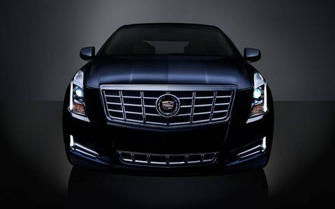 The 2013 Cadillac XTS Premium Collection has a grille that isn't as aggressive as those found on other Cadillacs, but the car's distinctive style still stands out.