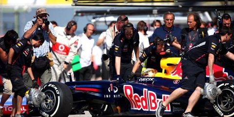 A qualifying infraction will move points leader Sebastian Vettel from third to the back of the pack to start Sunday's race at Abu Dhabi.