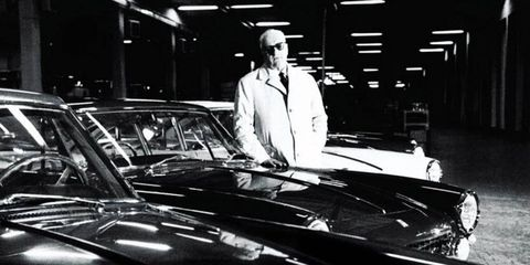 Enzo Ferrari with a few of his four-wheeled creations in the 1960s.