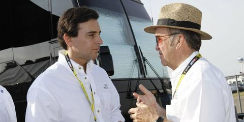 Ford executive Mark Fields, shown talking with NASCAR team owner Jack Roush, has become the likely successor to CEO Alan Mulally.