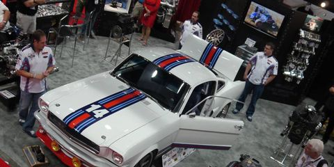 Steve Strope, left, shows off his Martini Mustang at SEMA.