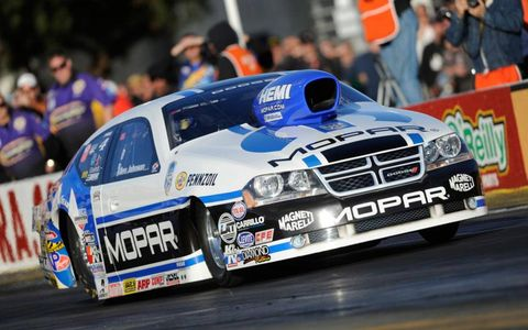 Allen Johnson clinched the Pro Stock championship in qualifying and capped his season with the event win at Pomona on Sunday.