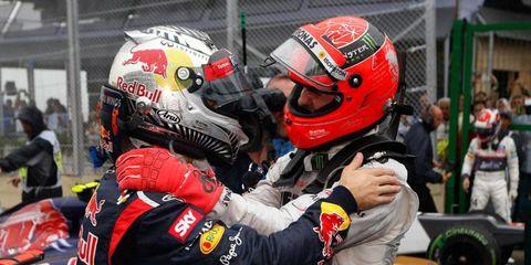 Sebastian Vettel, left, celebrates his third Formula One World Championship with seven-time champion Michael Schumacher in Brazil on Sunday.