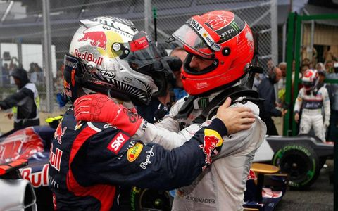 Sebastian Vettel, left, celebrates his third Formula One World Championship with seven-time champion Michael Schumacher in Brazil on Sunday.