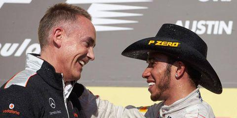 Team principal Martin Whitmarsh, left, and driver Lewis Hamilton celebrate a win on the podium in Austin, Texas.