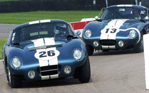 2004 Goodwood Revival Meeting Goodwood, England. 3rd - 5th September 2004. Royal Automobile Club Morton/Bowman leads Gerber/Bondurant (Shelby American Cobra Daytona)