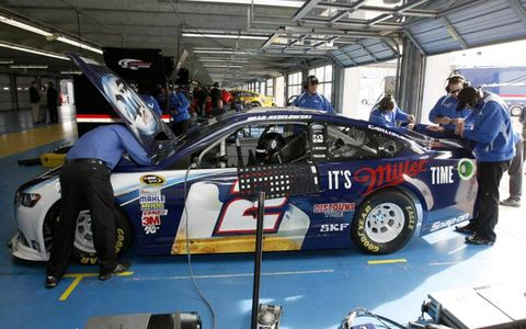 Keselowski's crew works on his new Ford.