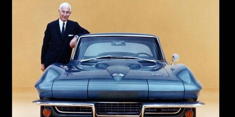 Chevy Corvette chief engineer Zora-Arkus Duntov stands with a 1966 Corvette.