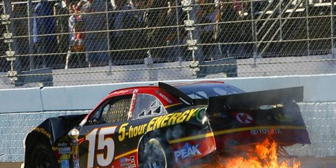 Clint Bowyer limps around the track, his car on fire, after being intentionally wrecked by Jeff Gordon in Phoenix.
