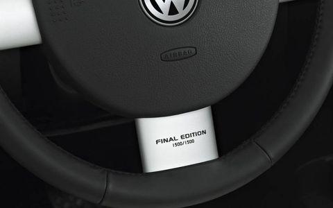 Motor vehicle, Automotive design, Automotive exterior, Logo, Machine, Symbol, Circle, City car, Carbon, Trademark,