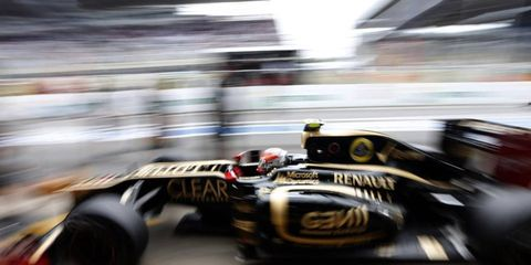 Romain Grosjean has committed to stay at Lotus in 2013.