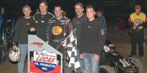 Tony Stewart, center, showed on Saturday night that he still knows his way around a short track, winning in Illinois.