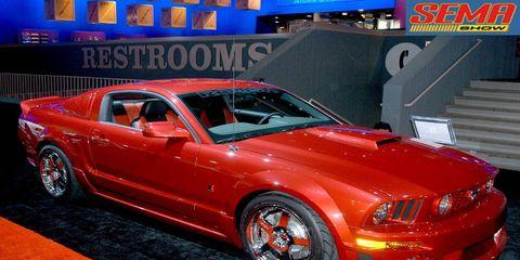Tire, Automotive design, Vehicle, Automotive tire, Hood, Car, Red, Automotive lighting, Rim, Headlamp,