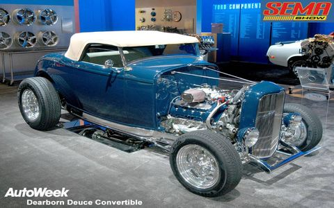 Tire, Wheel, Motor vehicle, Automotive tire, Automotive design, Blue, Mode of transport, Land vehicle, Vehicle, Automotive wheel system,