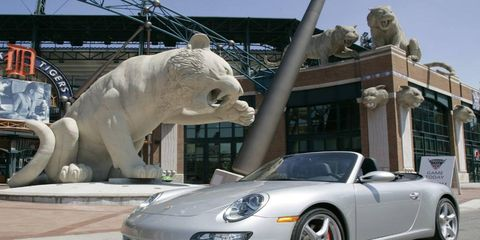 Automotive design, Car, Rim, Alloy wheel, Sculpture, Fender, Automotive lighting, Performance car, Sports car, Luxury vehicle,