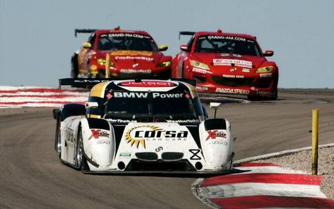 The #8 BMW Riley of Ryan Dalziel and Mike Forest leads a pack of cars down a hill, Utah 250 atMiller Motorsports Park, Sept. 10-11.