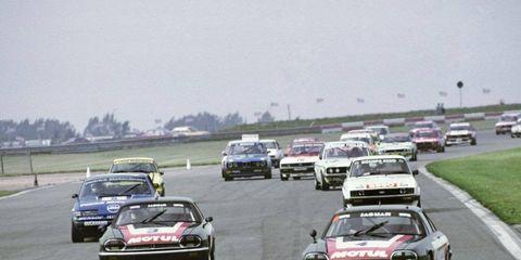 Pierre Dieudonne/Pete Lovett, Jaguar XJ-S, leads Tom Walkinshaw/Chuck Nicholson, Jaguar XJ-S. 1982 Tourist Trophy, Silverstone, England.