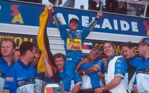 Michael Schumacher celebrates becoming World Champion with Flavio Briatore, Tom Walkinshaw and the rest of the Benetton team at the 1994 Australian Grand Prix.