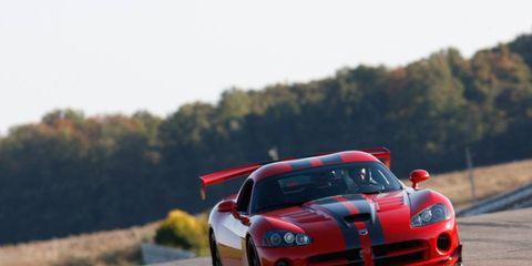 Automotive design, Vehicle, Sports car racing, Motorsport, Performance car, Car, Automotive lighting, Hood, Race track, Sports car,