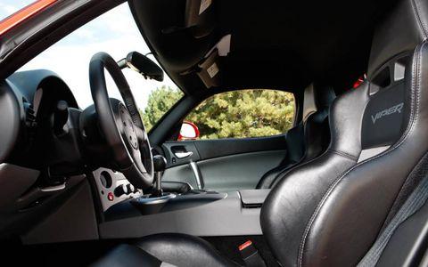 Motor vehicle, Mode of transport, Automotive design, Steering part, Transport, Steering wheel, Car, Automotive mirror, Carmine, Car seat,