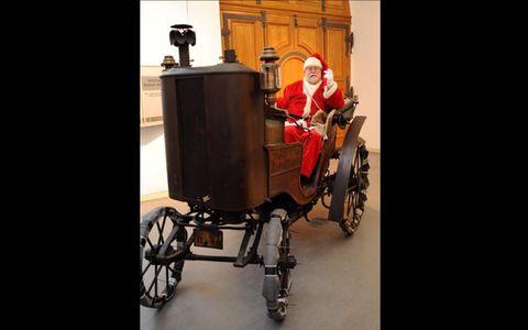 Santa's New Ride // Santa Claus presents Gustav Asolf Schoeche's 1895 steam vehicle at the Dresden Traffic Museum in Dresden, Germany. Photo by: Matthias Hiekel/DPA/ZUMAPRESS.com