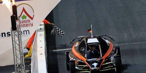 Sebastian Vettel takes the checkered flag on Saturday in Thailand.