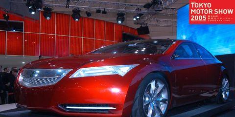 Mode of transport, Automotive design, Vehicle, Event, Land vehicle, Car, Auto show, Automotive lighting, Personal luxury car, Exhibition,