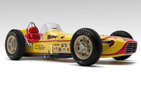 A highly detailed scale Offenhauser engine sits under the hood of this 1958 Belond Special Indy Car model.