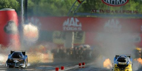Todd Lesenko, right lane, leaves the starting line at the Mac Tools U.S. Nationals in Indianapolis.