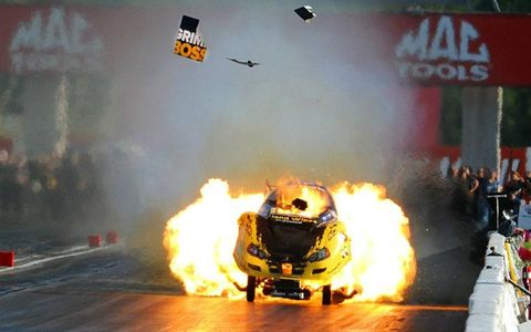 Todd Lesenko's Funny Car explodes near the finish line in Indianapolis.