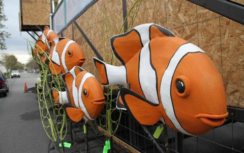 Clown fish adorn the sides of the float