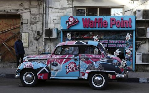 """MMMMM, WAFFLES // Waffle Point, located in the Heliopolis region of Cairo, Egypt, boasts the slogan """"a taste of excellence."""" Its delivery car? Er, not so much."""