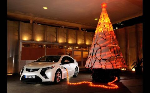ALL CHARGED UP // Vauxhall spread a little Christmas joy, charging its Ampera (Volt to us in the States) with a Christmas tree, part of a promotion touting Vauxhall's 30-day satisfaction guarantee on Ampera. Customers can buy it, try it and if it doesn't suit, return it within 30 days, no questions asked. Batteries included.