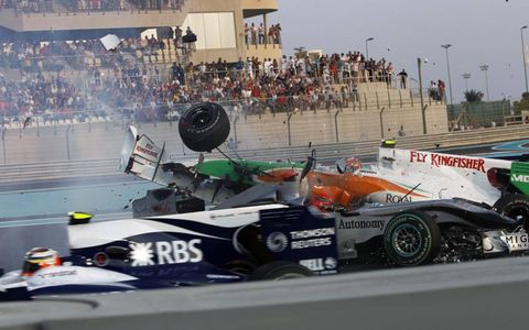 Vitantonio Liuzzi's Force India VJM03 Mercedes collides with Michael Schumacher's  Mercedes GP W01 on the opening lap of the 2010 Formula One Abu Dhabi Grand Prix, Nov. 14.