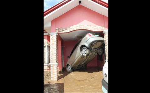 TIGHT SPACE // A flash flood tossed this car into in an entrance to a house in Cagayan de Oro on Mindanao Island in the southern Philippines. Tropical storm Washi hit the Philippines killing nearly 500 people, with nearly 200 still listed as missing.