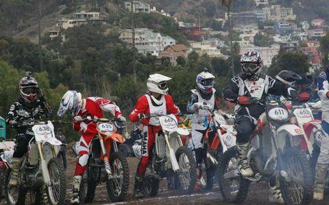 Wheel, Tire, Motorcycle, Motorcycle helmet, Automotive tire, Motorcycle racing, Motorcycling, Motorsport, Motorcycle racer, Soil,