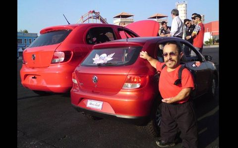 """MINI ME // Douglas, a dwarf who works at Beto Carrero World Park in Brazil, shows off the Volkswagen Mini Gol, billed as a """"car for little people."""" The car is a copy of the Brazilian-built VW Gol subcompact, but only 30 percent smaller. The car is powered by a 5.5-horsepower engine that can accelerate the Mini Gol to just 16 mph."""