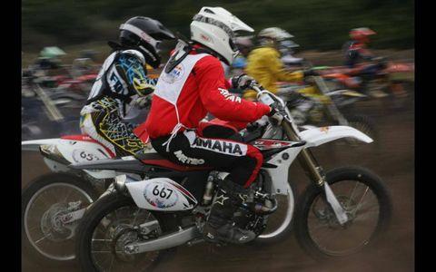 Tire, Motorcycle, Wheel, Motorcycle helmet, Shoe, Land vehicle, Helmet, Motorcycle racing, Motorcycling, Motorsport,