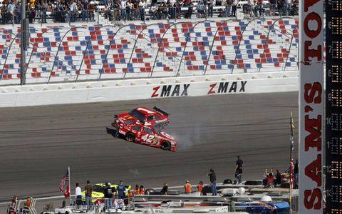 Juan Pablo Montoya and Jamie McMurray crash in Turn 4 at Las Vegas on February 29, 2010