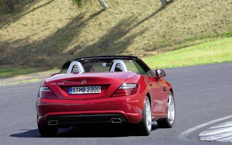 Automotive design, Vehicle, Road, Car, Asphalt, Performance car, Vehicle registration plate, Road surface, Mercedes-benz, Personal luxury car,