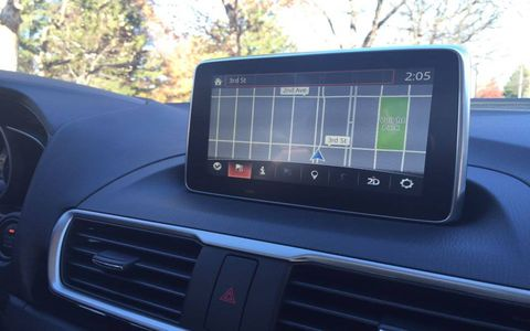 The infotainment system screen looks like an iPad was slammed into the dash, and it doesn't look too out-of-place.
