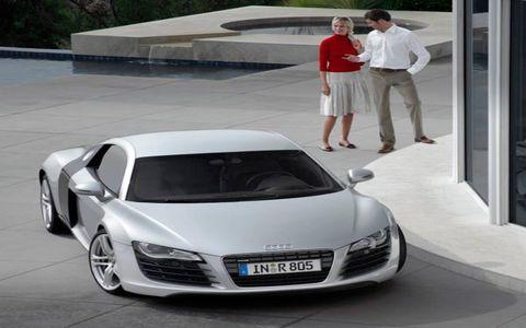 Automotive design, Vehicle, Automotive mirror, Car, White, Personal luxury car, Fender, Vehicle door, Sports car, Luxury vehicle,